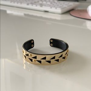 Black leather and gold cuff bracelet